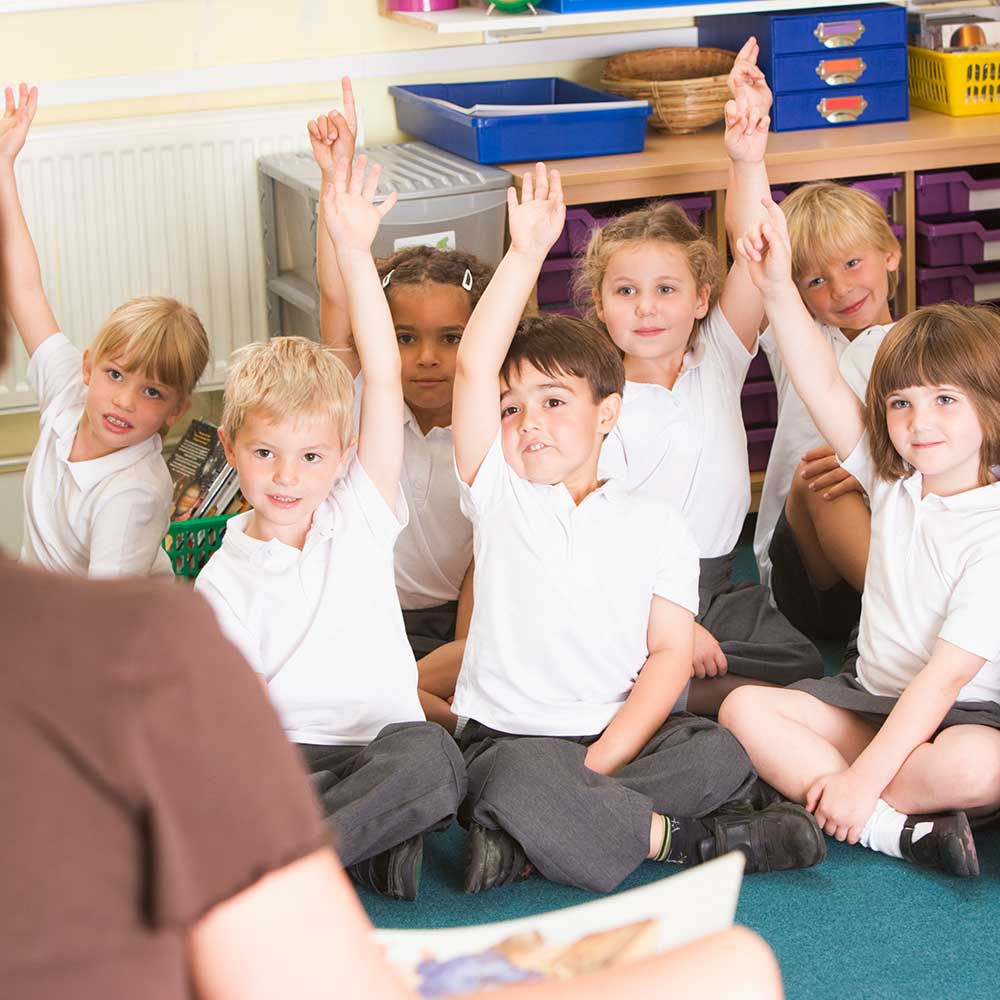 Primary school children sat on the floor engaging and learning about RSHE